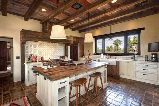 High Wooden Ceilings And Tile Floor Complement The Adobe Walls And