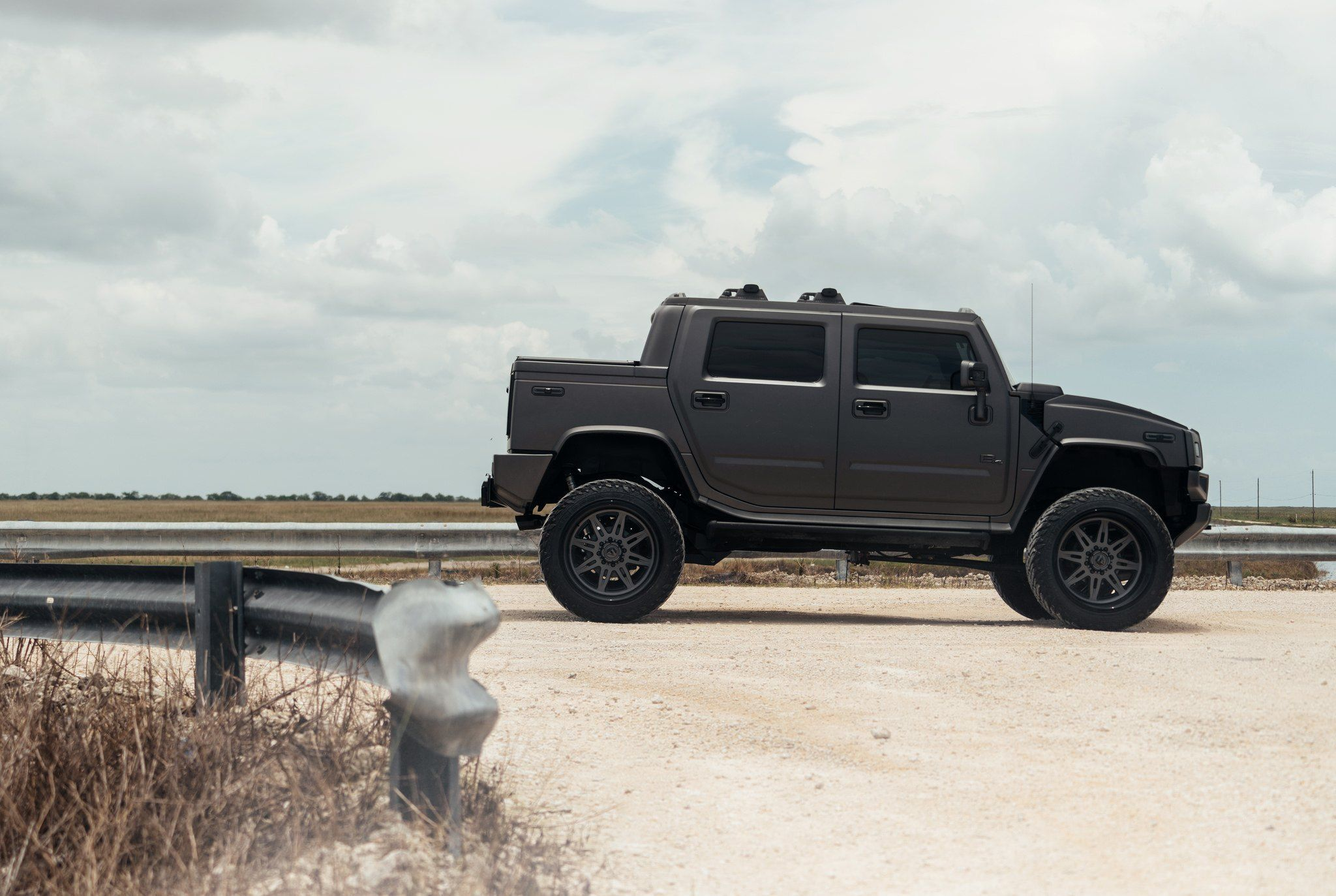 hight resolution of mean looking hummer h2 sut with a lift and fuel off road wheels