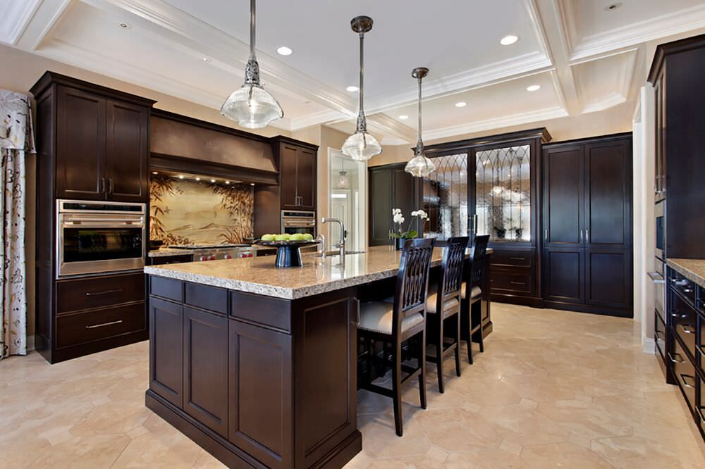 Incroyable Luxurious Kitchen Design With Rich Wood Throughout, Loads Of Storage, A  Large Island And Two Wall Mounted Ovens.