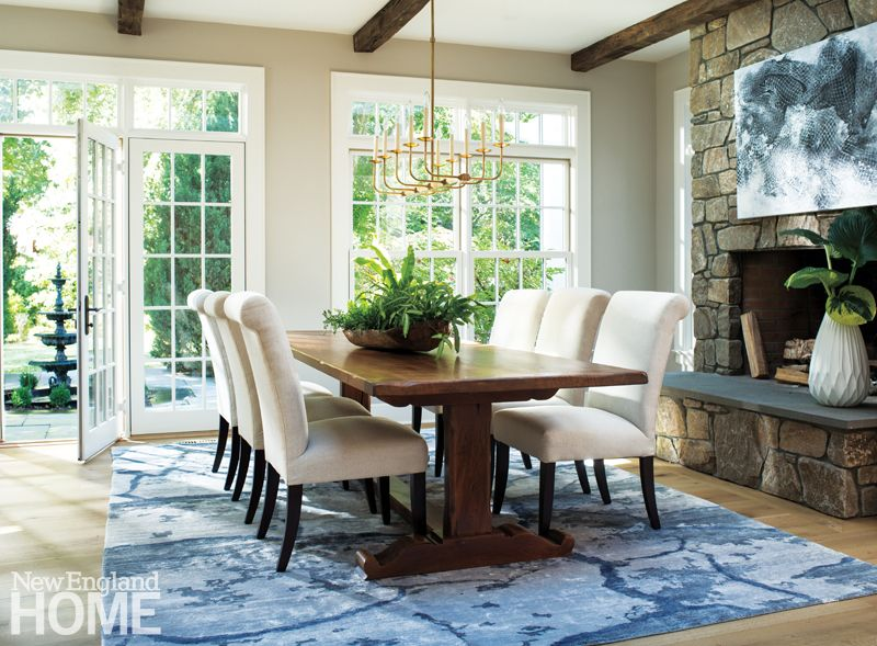 A Comfortable Dining Room With Upholstered Seats, A Rustic Farm Table, And  Cozy Fireplace Images