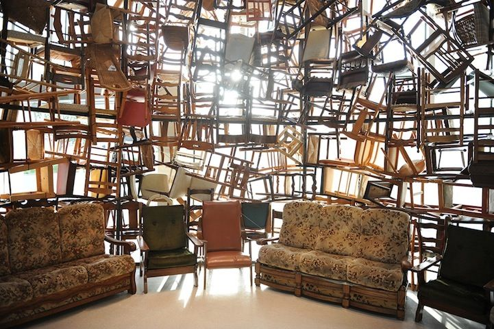 Massive Tower Made Of Hundreds Of Stacked Chairs Design Scenic Design Chair