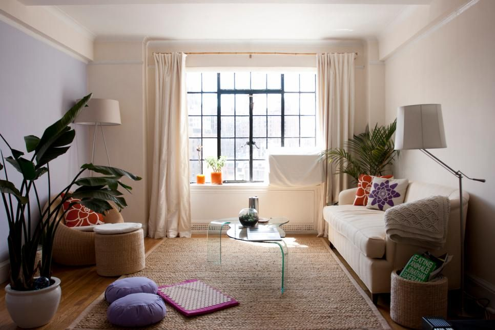 a light rug can open up your room and make it feel larger says langdon a bound carpet remnant can work great if your apartment came with stained or