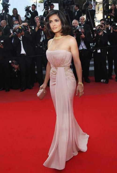 cb40604713b Salma Hayek wore an antique pink silk georgette Gucci Premiere strapless  gown with pale gold beaded cluster detail in the front and around the  waist, ...