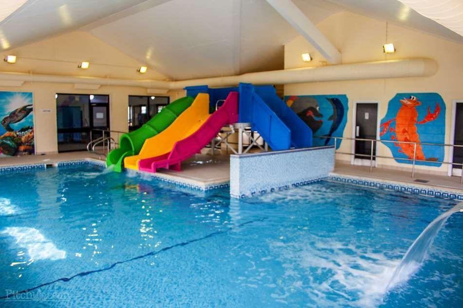 Indoor Swimming Pool With Slides Indoor Swimming Pools Swimming Pools Swimming Pool House