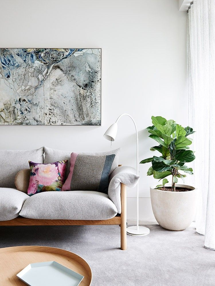 Scandinavian Living Room With A Grey Couch Wooden Table Green Plant