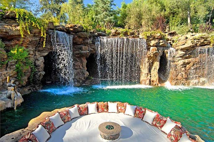 Luxury Swimming Pools With Waterfalls a luxurious pool with a waterfall and a cave at old lion manor