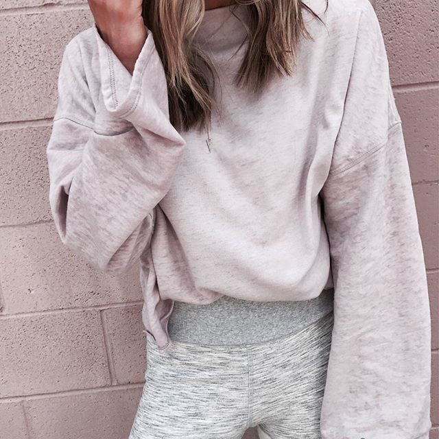 This slouchy pullover can be worn off the shoulder, it's under $50 and comes in 5 colors.