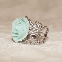 This ring is so cute.  The lovely rose {about 1 inch wide} is securely attached to an adjustable silver filigree band {nickel free}. The band fits sizes 5-10...
