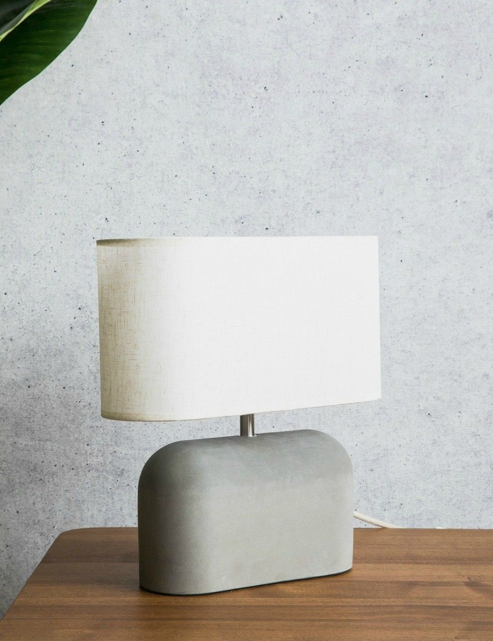 Small Concrete Table Lamp is part of Home Accessories Decor Lamps - Overall Height 37cm Shade H 18cm x W 33cm x D 13cm Base H 25cm x D 10cm Cable Length 180cm Requires a 1 x E27 bulb, Max wattage Eco Halogen 42  55W or LED 10W