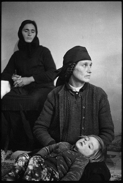 """Nikos Economopoulos ALBANIA. Mirdita region. Perlat village. The DONDA family """"forgave"""" the blood and has reconciliated with the SULEYMANIS. But the women still mourn the recent deads. 1998."""