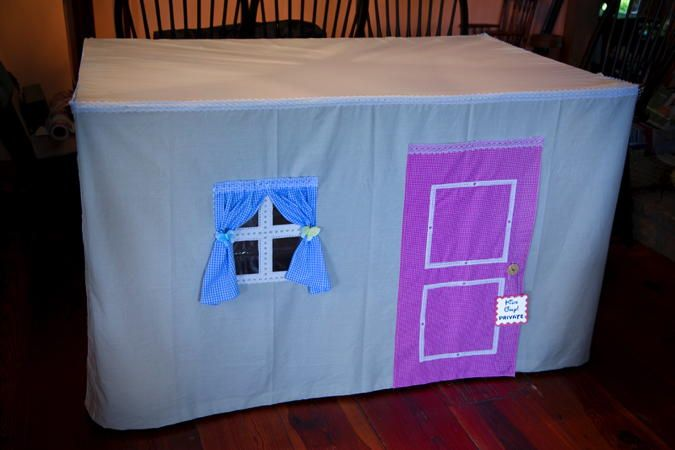 DIY Table Playhouse — this one uses a sheet instead of a tablecloth. Click thru for instructions.  #tableplayhouse #brightideas #tablelinenhacks