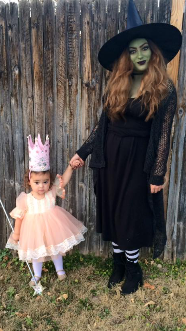 Wicked witch of the west and tiny Glinda the Good witch. Halloween ...