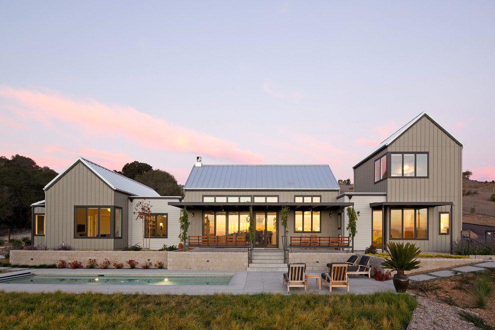 Modern gable roof design exterior farmhouse with farm house front yard metal trellis gable for Modern rustic farmhouse exterior