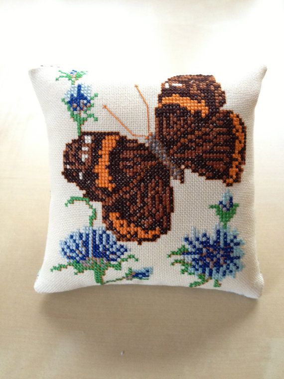 One of two embroidered butterflies I found on a market and turned into small decor pillows. Beautiful cross stitch embroidery! The back is made of Liberty of London Fabric. 14.5 cm (5.70 inch) x 14.5 cm (5.70 inch    www.etsy.com/shop/nellyslittlegifts    We combine postage and ship everywhere! Parcel costs are charged only once if multiple items are purchased, which makes browsing our other items even more worthwhile