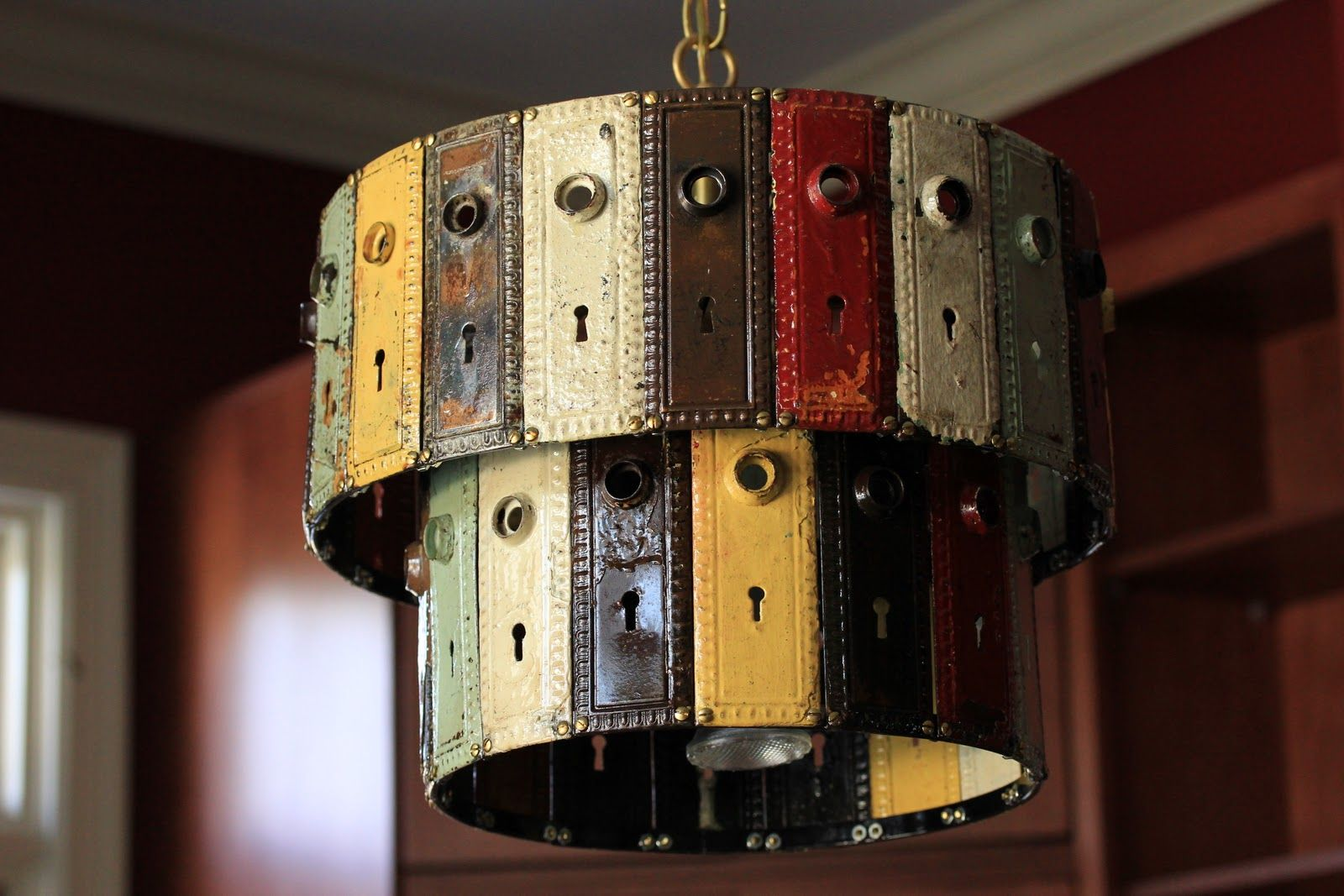 Cool light fixture made from old door handle plates bought some of