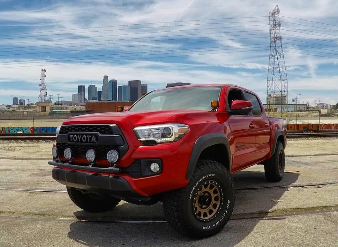 Image may contain sky, car and outdoor Toyota trucks