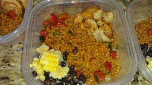 Spanish cous cous and shrimp ¦ Friend That Cooks blog    Spanish cous cous risotto with fresh tomatoes. Served with sauteed Chile rubbed shrimp, black beans and corn off the cob. Healthy and delicious meals for the family with Weekly Meal Prep from personal chefs in Kansas City and Wichita at www.friendthatcooks.com cooking service.