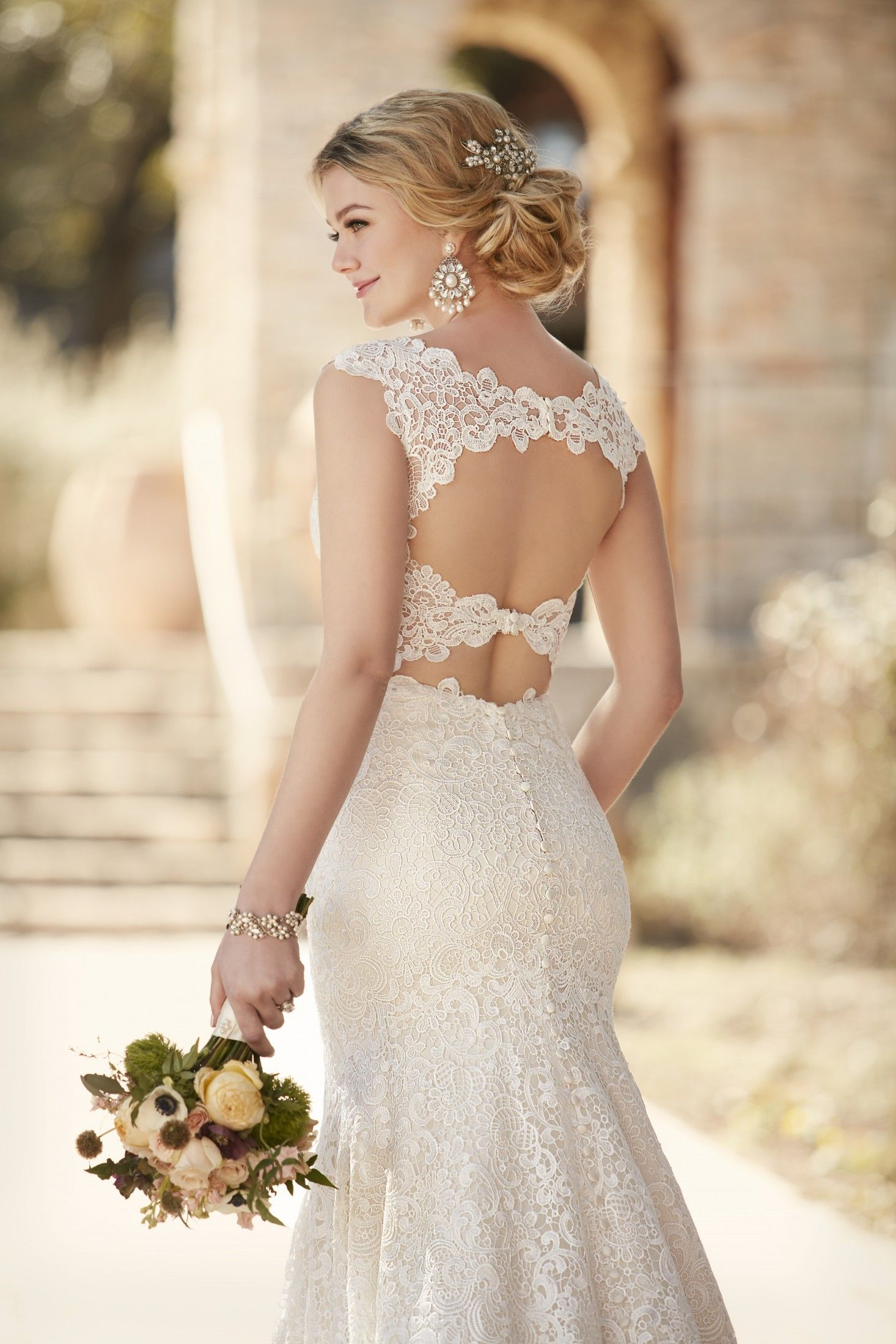 This designer sheath wedding dress from Essense of Australia is made