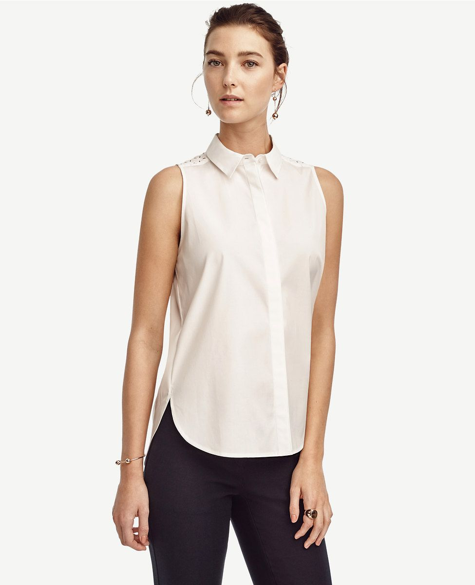 503fed84ed4189 Finished with an eyelet back yoke, this prettified classic button down tops  the season's most-wanted list. Point collar. Sleeveless. Hidden button  front.