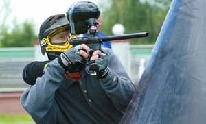 Players dodge paintballs and weave through obstacles on one of five outdoor fields, including a city-themed arena