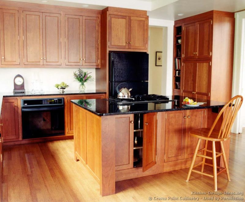 Kitchens With Light Wood Cabinets And Black Countertops Of