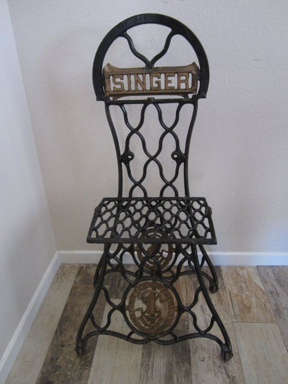 Cast iron chair built of antique singer sewing by for Repurposed metal furniture