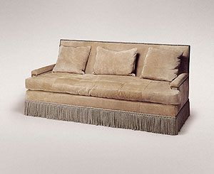 low arm sofa with loose seat cushion and tight back down cushion shown in suede with nail heads and bullion trim 37 inch height 37 inch depth 80 inch