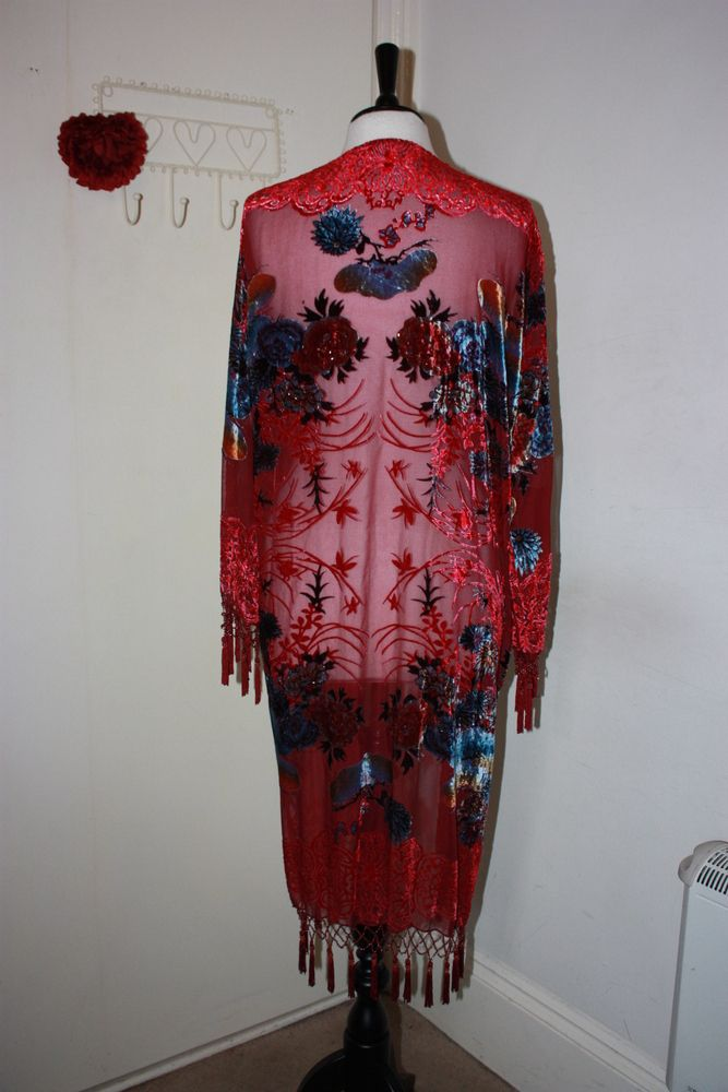 Just listed in my online store...This stunning kimono looks so delicate and ethreal. It features a red oriental design to the devore. This item is beaded.Colour: Red Size: One size fits all - xs/small/medium Fabric: Silk mix devore velvet Care instructions: Dry clean only Approx Length (including fringing): 110 cm Approx Bust (under arm to under arm then doubled): 126 cm