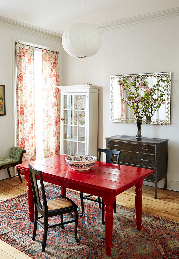 mixing periods: a red painted farm table, vintage carpet and