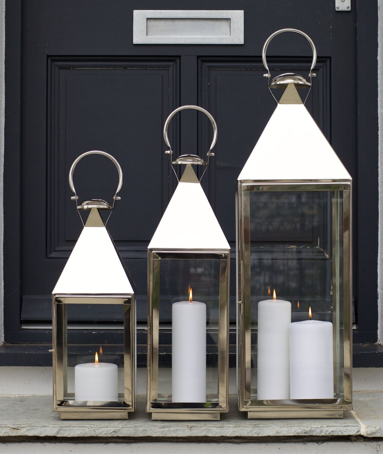 Classic And Contemporary Tall Stainless Steel Candle Lanterns Zazahomes Co Uk Outdoor Candle Lanterns Garden Candle Lanterns Silver Candle Lanterns