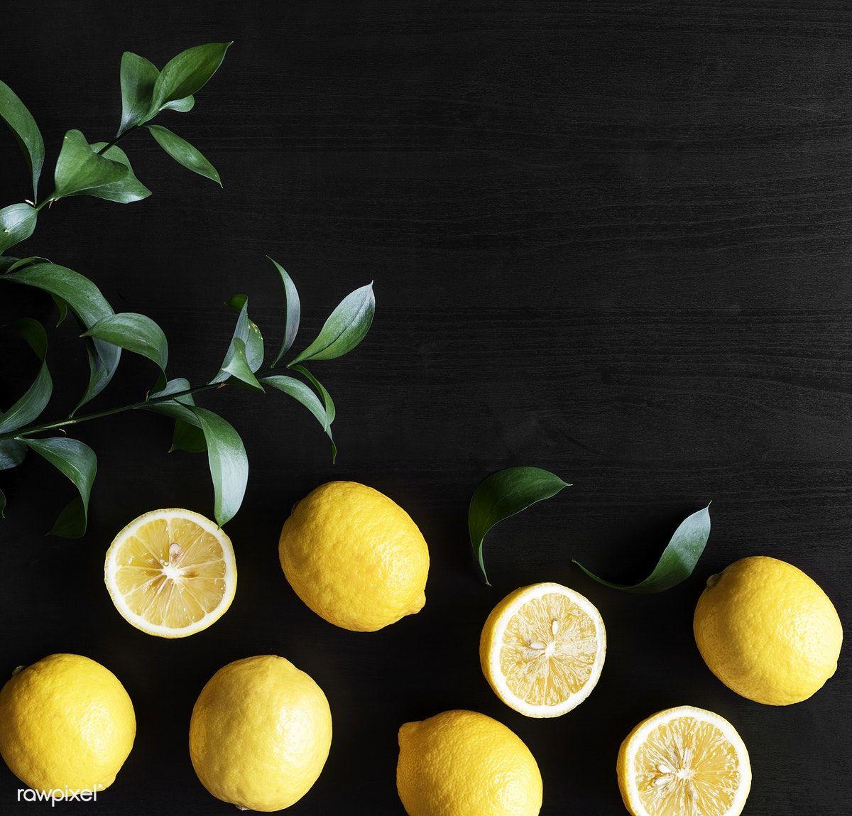 Download Premium Image Of Fresh Yellow Lemons On Black Background