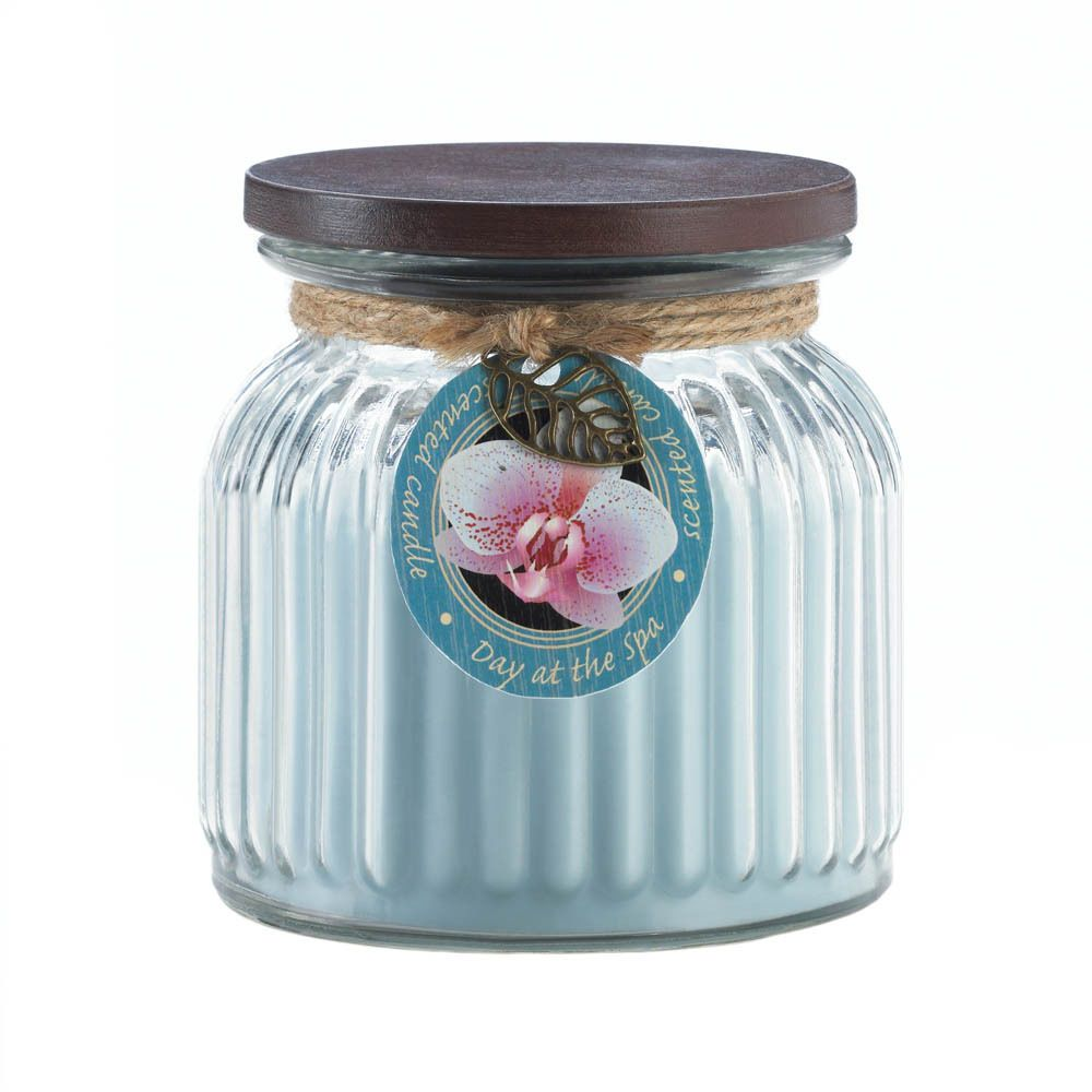 Create a spa-like ambiance in any room with this relaxing and rejuvenating jar candle. Warm floral notes and fresh scent will envelop your room with this ribbed jar candle with lid. #SPA #FREESHIPPING