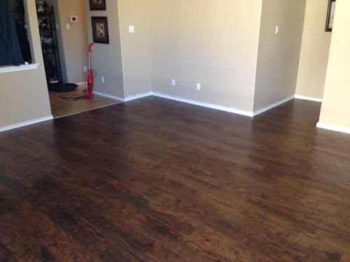 Trafficmaster Hand Scraped Saratoga Hickory 7 Mm Thick X 7 2 3 In Wide X 50 5 8 In Length Laminate Flooring 24 17 Sq Ft Case 34089 Brown Laminate Flooring Flooring Laminate Flooring
