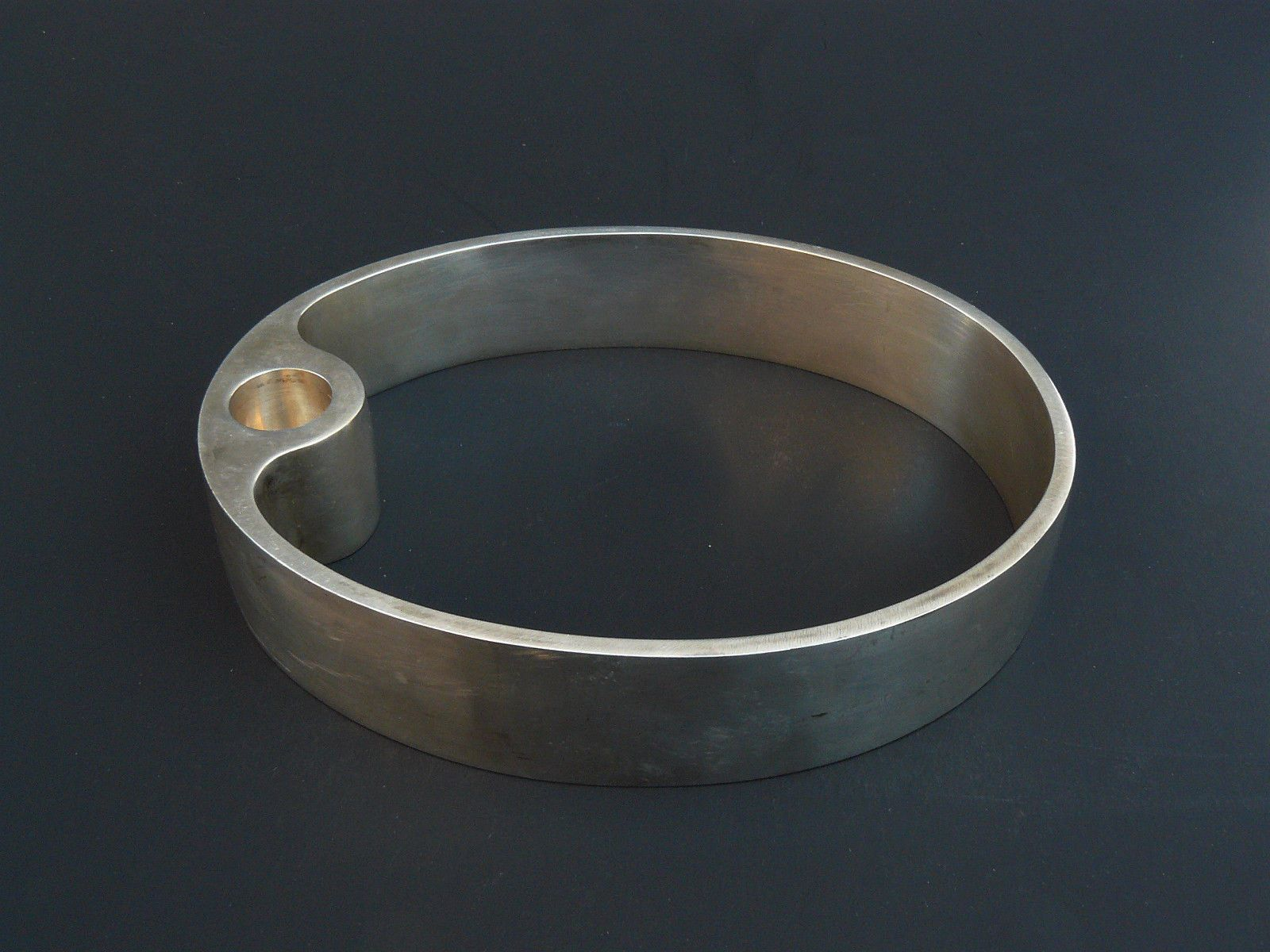 """Contemporary Metal Oval Ring Candle Holder Candlestick 7.5"""" and Heavy  A unique and simple design metal oval ring candle holder!  The material is non magnetic metal and heavy for its size.  No mark of the maker  The piece is in very good vintag..."""