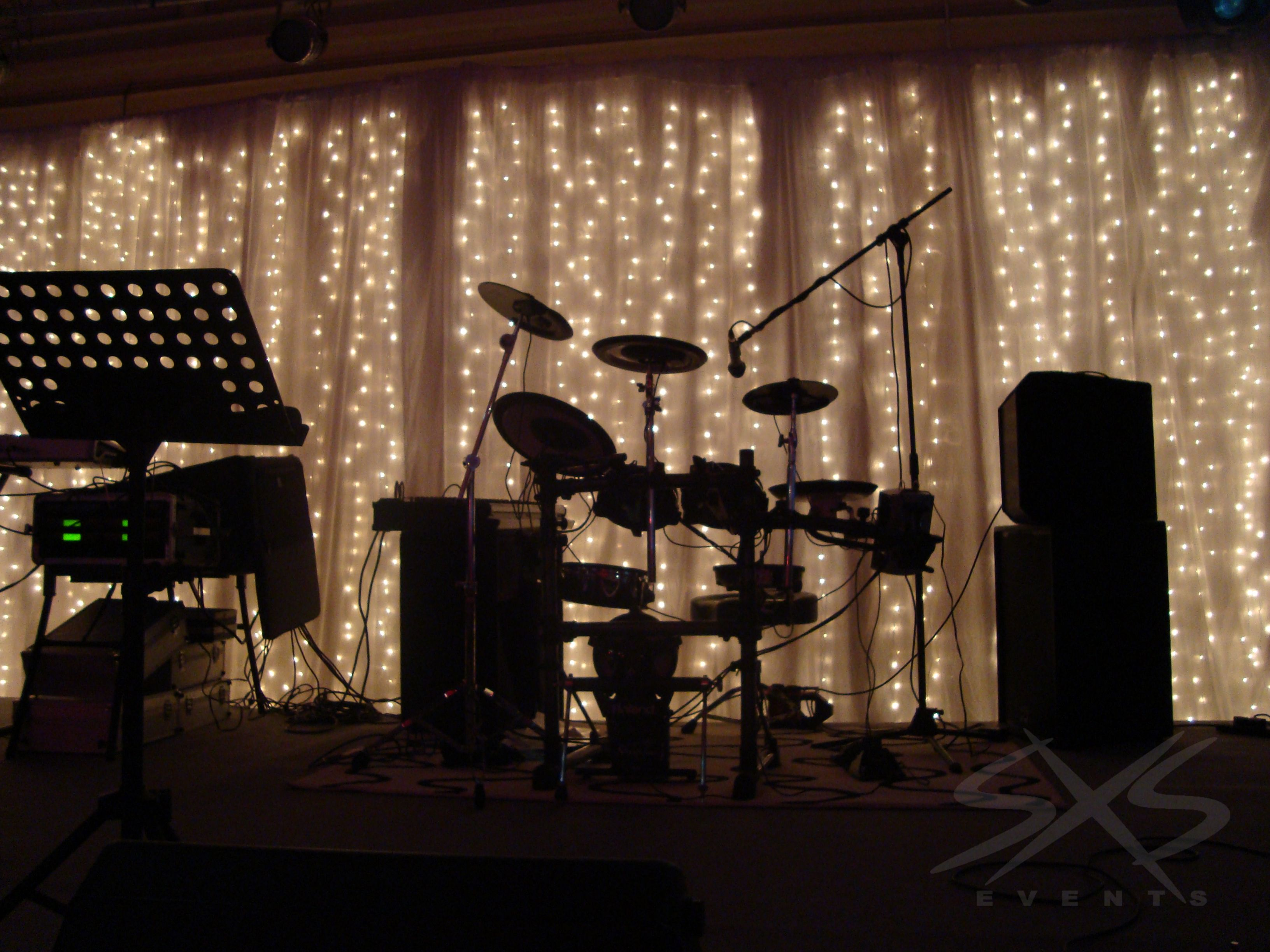 Fairylight curtain stage backdrop behind white drapes www for Backdrop decoration for church
