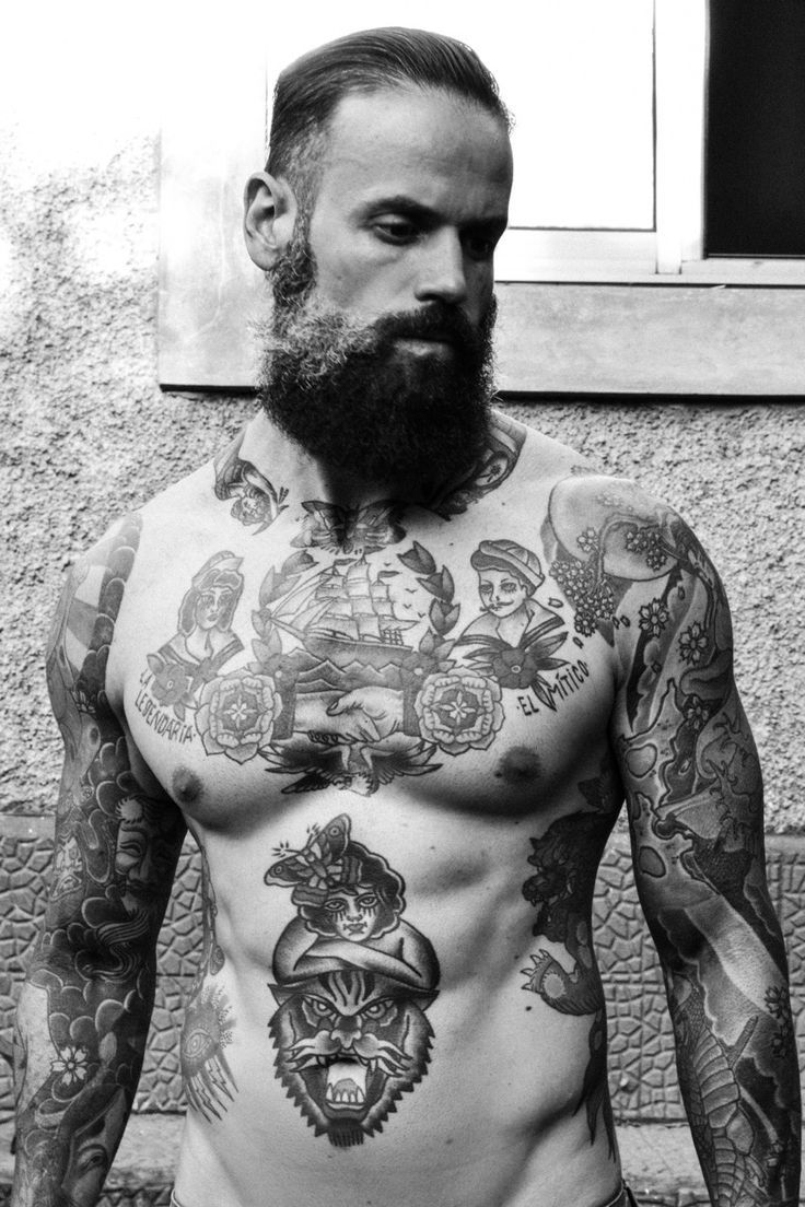 Some Serious Tattoos Going On Here But Mainly An Impressive Beard