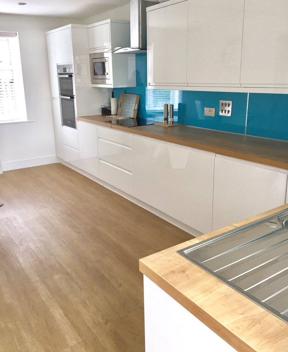 kitchen installation using selkie wall panel in 'blue