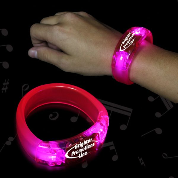 """Pink Soundsation Light Up LED Bangle Bracelet. This amazing new bracelet moves to the beat of any music!  Give your clubwear a brightly lit boost with our colorful 8"""" plastic Sounsation light up bangle bracelet. Perfect for promoting concerts, clubs, and parties! One size fits most wrists. Very visible promotional product. Batteries included and installed."""