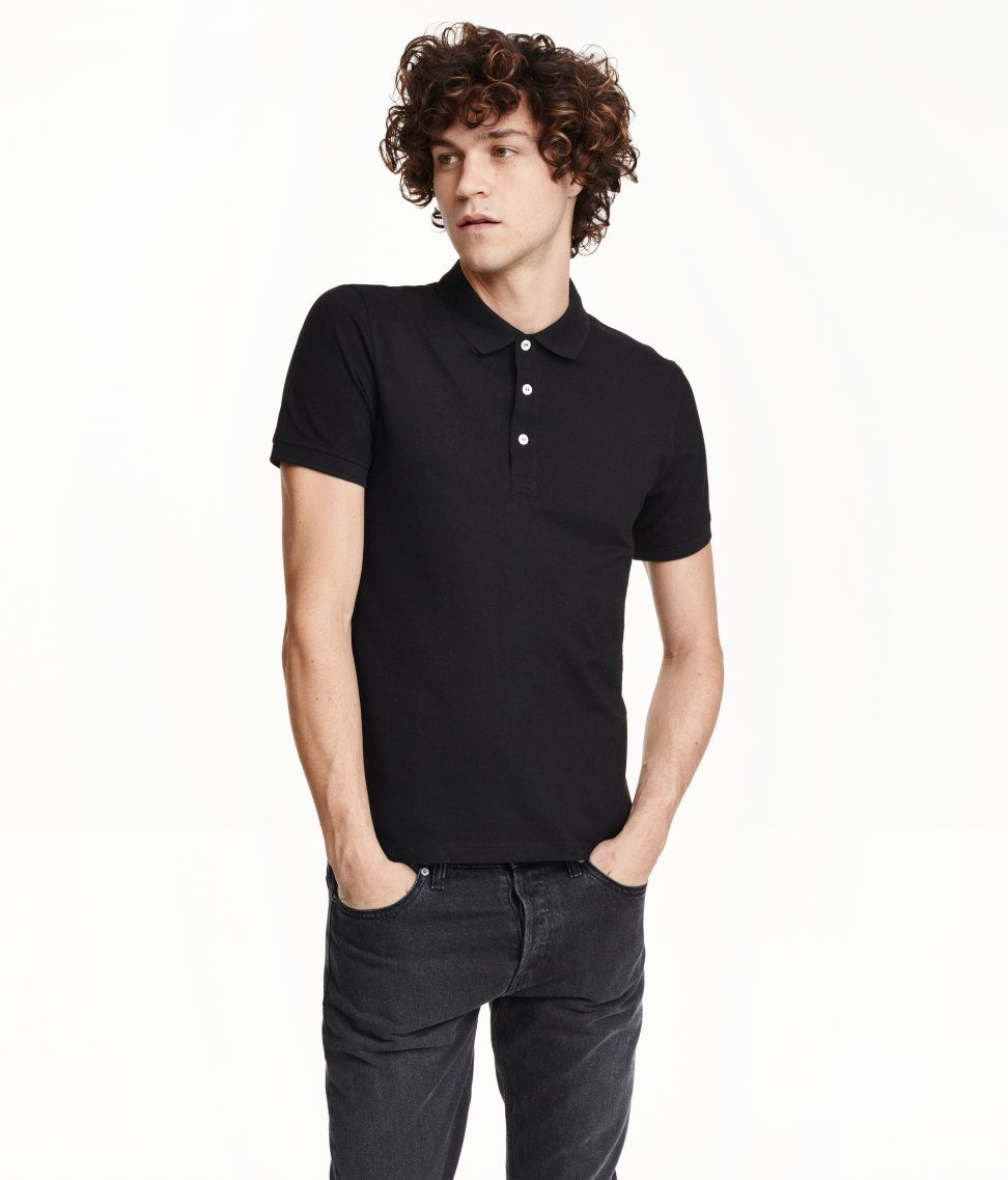 Short-sleeved polo shirt in cotton jersey with a ribbed collar and short button placket. Ribbing at cuffs and short slits at sides.