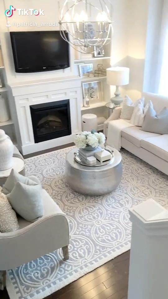 Neutral living room, in shades of cream, white, and powder blue. #LivingRoom #NeutralRoom #NeutralHome #HomeDecor #FireplaceBuiltIn #ShelfStyling