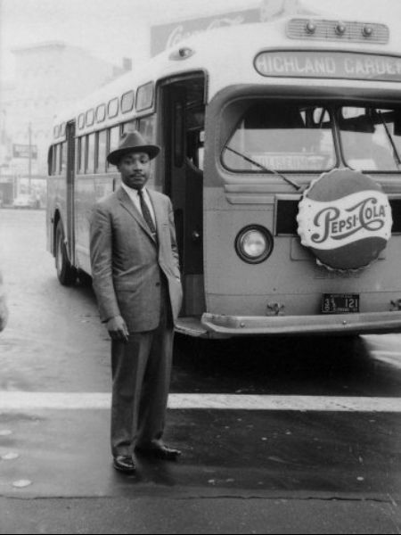 Montgomery Bus Boycott Reverend Martin Luther King, Jr. stands in front of a bus at the end of the Montgomery bus boycott, Montgomery, Alabama, Dec. 26, 1956.