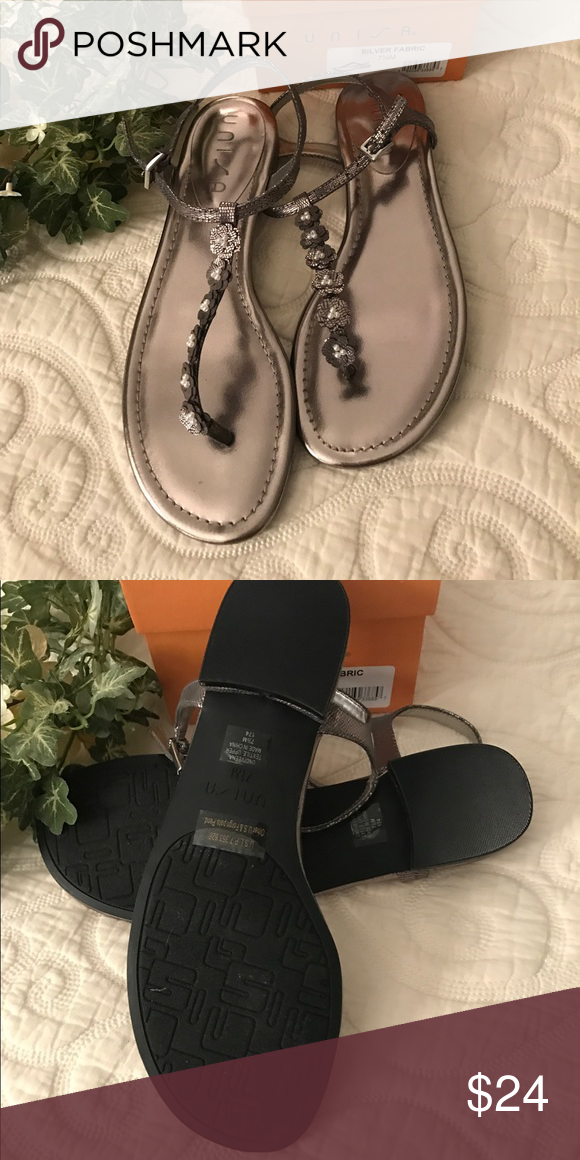 Unisa Sandals Cute sandals in a bronze color.  Cute flowers with pearls run down the front.  New with box.  Reasonable offers only.  And come from a smoke free pet free home. unisa Shoes Sandals