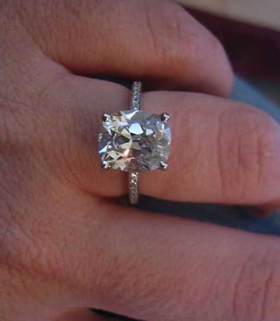 solitaire 2 carat cushion cut engagement ring with thin diamond .