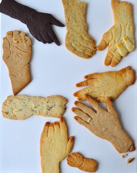 My mom always made hand cookies when I was growing up. We'd place our hand on the rolled out dough, and she trace the shape with a butter knife. And we'd decorate it (add rings and bracelets) with frosting when the cookies were done baking.