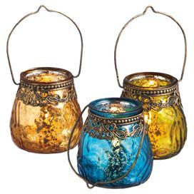 """Set of 3 glass votive candleholders with assorted finishes and filigree trims.  Product: 3-Piece votive holder setConstruction Material: Metal and glassColor: Orange, yellow and blueAccommodates: (1) Candle each - not includedDimensions: 3.125"""" H x 3.125"""" Diameter eachNote: Includes (2) 3-piece candleholder sets. Customer will receive two of each candleholder pictured."""