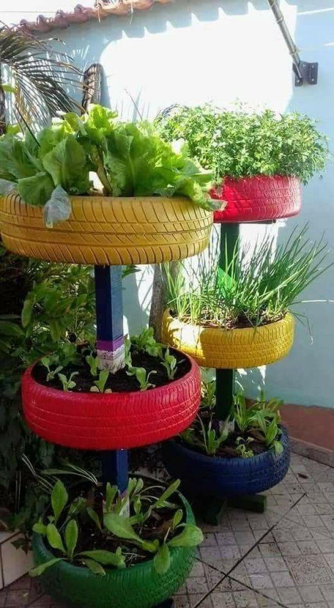 Pin By Bruna Mendes On Mini Jardim Pinterest Tire Garden And Vegetables Auf Bruna Con In 2020 Diy Backyard Landscaping Vertical Garden Planters Tire Garden