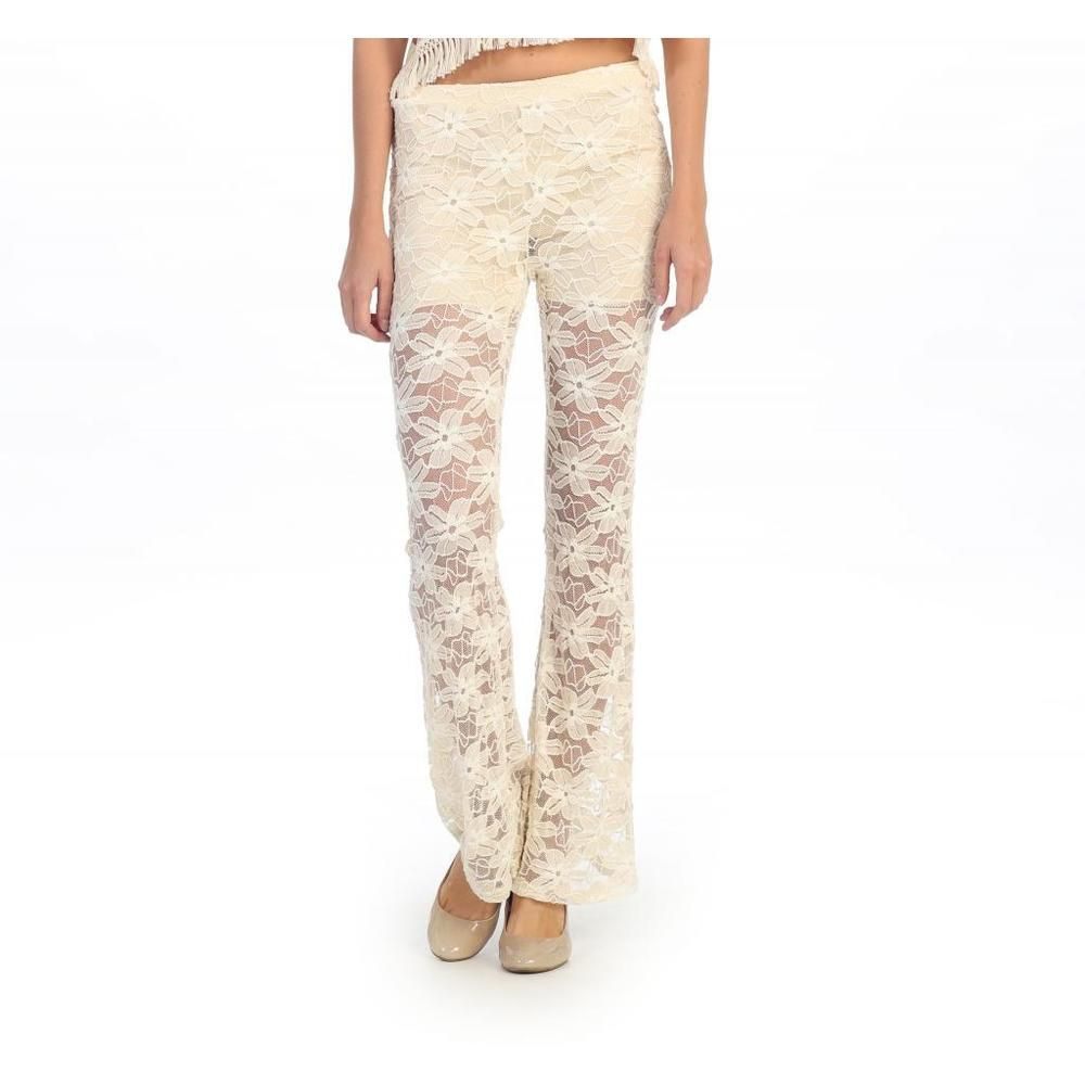 This pair of decoratively detailed palazzo pants boasts haute-hippie appeal and features an elasticized waistband and relaxed fit for casual outdoor scenes.