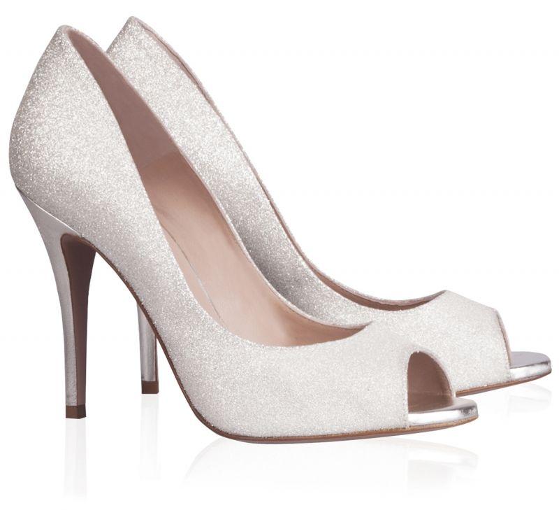 311fcc5b00e Pura Lopez Dana- Zapatos peep toe de Pura López realizados en glitter  degradé blanco roto con tacón stiletto en piel metalizada.
