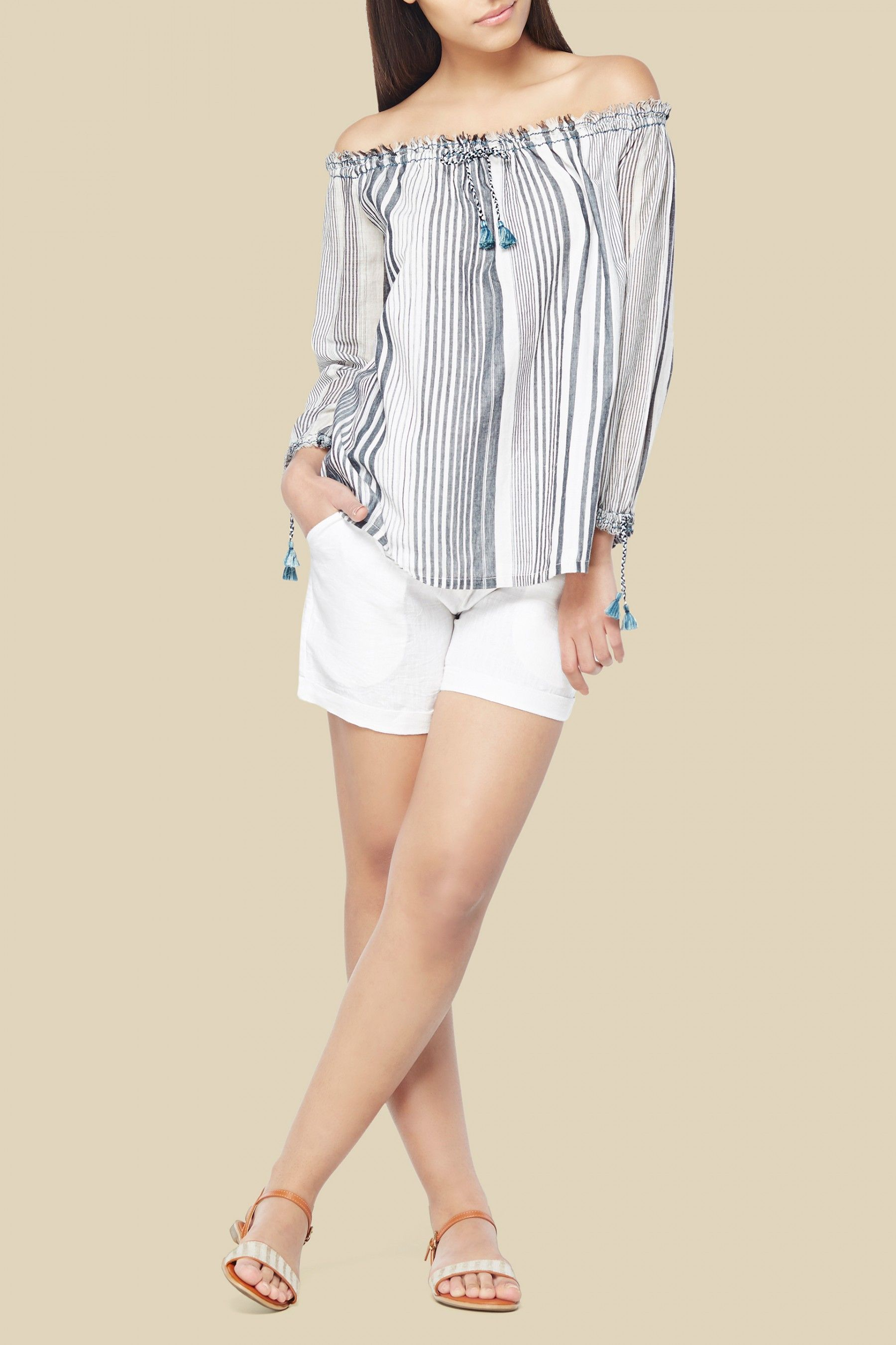 81a7ae8882ab8 A grey striped off-shoulder handwoven cotton top with full sleeves and tie- up blue tassel detailing on the front and on the elasticated cuffs.