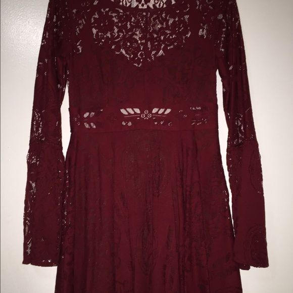 Free People Lace and Cutout Dress Beautiful deep red lace and cutout dress from free people. Great bell sleeves, cutout in low back, covers in all the right places. Easily worn bra-less. Size 4. Such a fun party dress. Free People Dresses Mini
